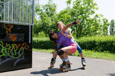 Two rollerbladers practising at the skate park — Foto de Stock