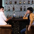 Young man and woman chatting at the bar — Stock Photo