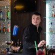 Barman serving a customer — Foto Stock