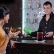 Barman chatting with a female customer — Stock Photo