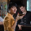 Women drinking at a pub counter — Stock Photo