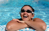 Woman smile at the side of a swimming pool — Stock Photo