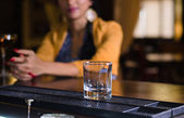 Empty tumbler on a bar counter — Stock Photo