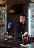 Barman serving a customer — Stock Photo