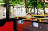 Cute little boy riding in a bus or tram — Stock Photo