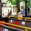 Small boy in a sightseeing tram or coach — Stock Photo #37272093