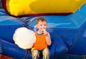 Cute small boy enjoying a stick of candy floss — Stock Photo
