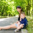 Mother and son waiting in a rural street — Stock Photo