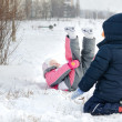 Two small children frolicking in the snow — Stock Photo