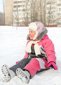 Happy little girl playing in cold winter snow — Stock Photo
