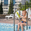 Young boy playing in a swimming pool — Stock Photo