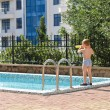 Young boy standing at the edge of a pool — Stock Photo
