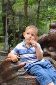 Young boy sitting thinking — Stock Photo