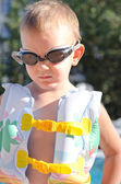 Little boy in swimming goggles on a hot summer day — Stock Photo