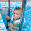 Cute little boy enjoying a swim in a pool — Stock Photo #39806911