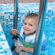 Cute little boy enjoying a swim in a pool — Stock Photo