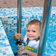 Cute little boy enjoying a swim in a pool — Stock Photo #39806917