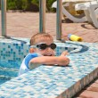 Cute little boy playing at the edge of a pool — Stock Photo