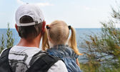 Father holding his young daughter at the seaside — Stock Photo