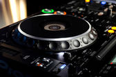 Turntable on a DJ music deck — Stok fotoğraf
