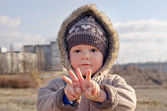 Cute young boy making V-sign gestures — Stock Photo