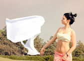 Young womans white scarf blowing away in the wind — Stock Photo