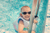 Laughing little boy climbing out of a pool — Stock Photo