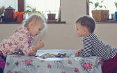 Young boy and girl playing checkers — Stock Photo