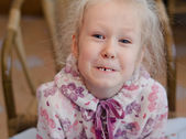 Funny little girl showing off her missing tooth — Stock Photo