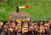 Kebabs sizzling over a hot BBQ fire — Stock Photo