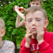 Two young boys pulling faces — Stock Photo #45812953