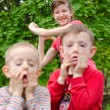 Two young boys pulling faces — Stock Photo #45812993
