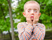 Little boy pulling a scary expression — Stock Photo