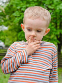 Little boy standing picking his nose — Stock Photo