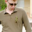 Handsome man posing with a lizard on his shirt — Stock Photo #46978661