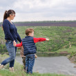 Little boy pointing to something in the country — Stock Photo #46978809