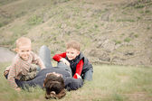 Two young boys playing with their mother — Stock Photo