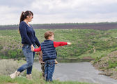 Little boy pointing to something in the country — Stock Photo