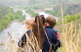 Mother with two boys enjoying a day in nature — Foto de Stock