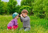 Young boy and girl playing with binoculars — Stock Photo