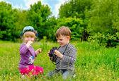 Little girl and boy playing with binoculars — Stock Photo
