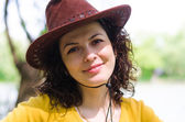Beautiful woman in a trendy leather hat — Stock Photo