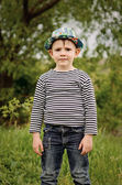 Happy little boy in a colorful blue hat — Stock Photo