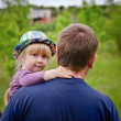 Cute little blond girl being carried by her father — Stock Photo #48217285