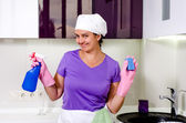 Cute happy playful housewife — Stock Photo