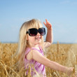 Adorable little blond girl in huge sunglasses — Stock Photo #48738679