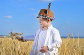 Little boy flying a toy plane in a wheat field — Stock Photo