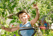 Young boy playing with a stick and gesturing — Stock Photo