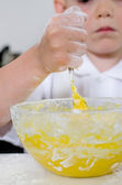Little boy mixing cake ingredients — Stock Photo
