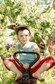 Barefoot little boy playing in the garden — Stock Photo